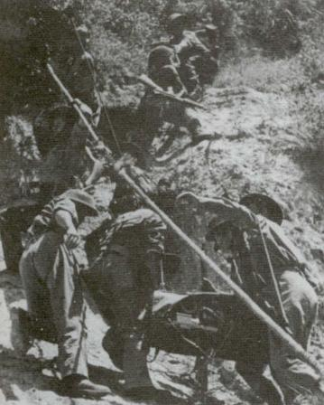 Polish soldiers transporting artillery pieces uphill